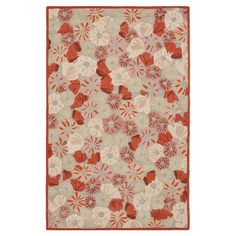 Perfect for anchoring a neutral seating group in the den or adding a pop of pattern to the master suite, this hand-tufted wool rug features a delightful popp...
