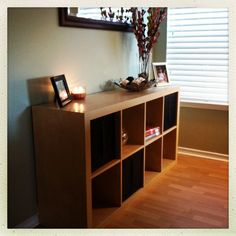Found a perfect storage unit from IKEA that is stylish and an organizing dream with decorative bins!!! Love it! :)