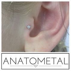 Fresh tragus piercing on Jamie with a 2mm prong set cz from Anatometal.