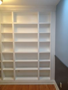 DIY: How To Install IKEA Bookcases So They Look Like Built-In's - lots of pictures and info on howl this project was done, including how to allow for electrical outlets and mouldings.