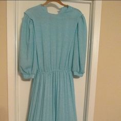 Vintage dress. Wow, wish I could fix this one. Beautiful blue and white vintage dress, with belt. Buttons in back. Pleated on the bottom. Dresses