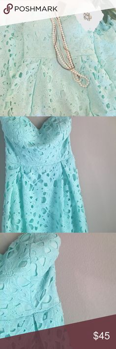 NWT lace strapless A line dress in mint/turquoise Gorgeous A line dress that is chic and classy in every sense of the word! I bought this for a wedding but did not end up wearing it. This dress is strapless with a zippered backing. Fits a size 26-27. The color is a light mint and not as Tiffany Blue as shown. Dresses Midi