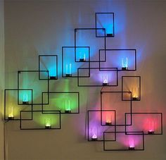 LED lights and glass votives create this geometric neon wall art. Wall Sconces with Hidden Weather Display and Tangible User Interface Deco Luminaire, Luminaire Design, Led Wall Sconce, Wall Sconces, Led Wall Lights, Wall Lamps, Candle Sconces, Tea Lights, Weather Display