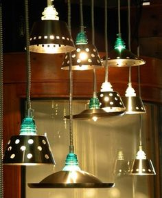 Collin Allen: glass insulator lights, 2011 Mixed Media Sculpture......Love the insulator glass colors :)
