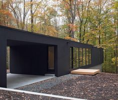 "Located in Bahama, North Carolina, Corbett Residence is a modern and minimal house that was designed by in situ studio and completed in ""The Corbett Residence is located on a wooded site, dow… Architecture Design, Plans Architecture, Residential Architecture, Shelters In The Woods, Black House Exterior, Casas Containers, Forest House, Modern House Design, Bungalow"