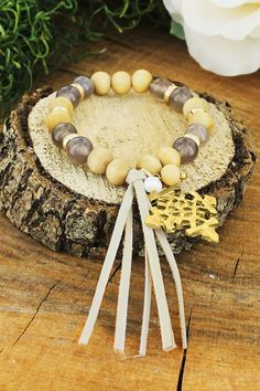 This bracelet will add a pop to any of your ensembles! Ethiopian Charm and Tassel Grey Stone Beaded Bracelet
