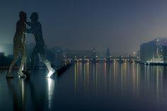 ღღ Berlin, Kreuzberg/Germany -  The Molecule Man Sculpture in the foreground and Oberbaum Bridge in the background ~~~ Foggy Morning in Berlin by Marcello Zerletti