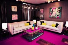 Pink rug and white furniture.