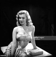 Studio portrait of American actress Marilyn Monroe as she poses in a strapless evening gown Hollywood California November 1948