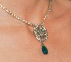 Princess Diana wearing the chain of brilliant-cut diamonds set in solid gold that was part of the sapphire and diamond suite she received as a wedding gift from the Crown Prince of Saudi Arabia, the detachable sapphire pendant removed and replaced with the diamond Prince of Wales feathers pendant given to her by Queen Elizabeth, the Queen Mother, as an engagement present, with its detachable emerald drop,