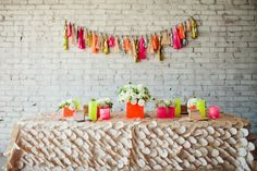 Neon Wedding Inspiration bridal shower wedding hot pink hot yellow hot orange flower petal table cloth