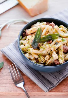 Strozzapreti with Pork Sausage, Shaved Brussel Sprouts, and Sage. Hearty and delicious pasta dish for fall!