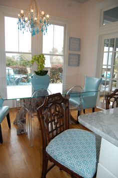 These chinoiserie barstools are HomeGoods scores! I reupholstered the seats in a aqua geometric -- sprayed with Scotchguard, they hold up to messy eaters.