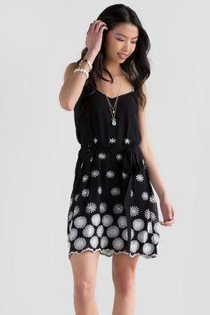 423375f24b3513 Dainty daisies decorate the Adelia Floral Embroidered Dress. This black  dress features white embroidered daisies with daisy chain straps
