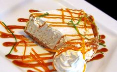Kumquat Pie with Caramel Sauce garnished with zest of lime and orange. Locally made in Dade City, FL. http://www.waterworksbarandgrill.com