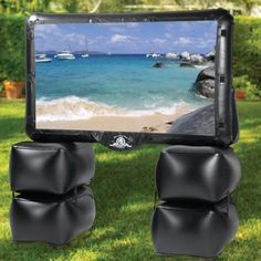 "hammacher outdoor theater.  72"" inch screen. Su su we need this for by the pool"