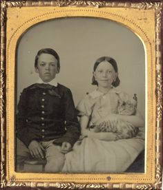 ca. 1855-60s, [ambrotype portrait of two children; the girl on the left apparently very pleased with her cat bundle]via I Photo Central, from Charles Schwartz Ltd.