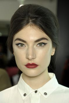 Always a classic, Pat McGrath opted for a red lip and cat eye at Dolce & Gabbana this Milan Fashion Week, but added a bit of a twist with a hint of glittery liner.