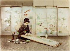 Decorating Screens    Large handtinted japanese albumen print.  Unidentified photographer, ca. 1900.