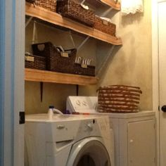 My utility room/ organized with baskets and chandelier.