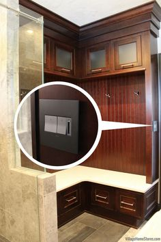 A lower level bathroom in the Quad Cities with custom storage locker and hidden laundry area. Design and remodel by Village Home Stores. Hidden Laundry, Drop Zone, Quad Cities, Mud Rooms, Laundry In Bathroom, Custom Cabinets, Bath Remodel, At Home Store, Cubbies
