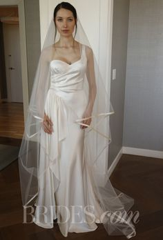"""Brides.com: Peter Langner - Spring 2014. """"Beauty"""" one-shoulder soft wedding dress with gathered skirt and draping front bust to floor, Peter Langner."""