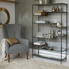 Tiered Tower Bookcase | West Elm: 42 x 14 x 69.5 $649 (in front of windows between dining nook and back of sofa)