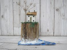 CLIFF TOP COTTAGE Wouldnt you just love to live here? It might get a bit blowy sometimes though.. !! Lovely little reclaimed wood house sits on a beautiful piece of driftwood that reminded me of a cliff face, so I just had to use it as one! The little cottage has been painted in chalk