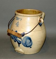 """4 quart cobalt decorated stoneware batter jug                          ca. 1870; salt glazed stoneware impressed """"Evan R. Jones Pittston, PA 4"""" with brushed cobalt design of feathered foliage round fruit or flower, cobalt around spout and handle terminals, wire bale handle with wooden hand hold and glazed interior"""