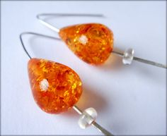 Lovely red Baltic amber and citrine on hammered hoops.