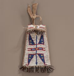 thread and sinew-sewn poncho style native tanned buffalo hide with cloth trim; beaded linear and geometric designs in colors of medium blue, red white-heart, cobalt, yellow, and pea green; American Indian Art, American Indians, Medicine Bag, Bead Loom Bracelets, Beaded Bags, Sioux, Western Art, Loom Beading, Geometric Designs