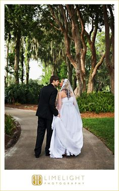Limelight Photography, www.stepintothelimelight.com, Wedding, Avila Golf and Country Club, Florida, Bride and Groom, Black, White, Green, Trees, Park, Veil, Wedding Dress, Kiss