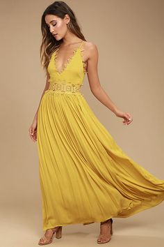 Lulus Exclusive! There's no doubt that the This is Love Mustard Yellow Lace Maxi Dress is a true stunner! From adjustable spaghetti straps, gauzy rayon falls to a plunging V-neck with crocheted lace trim. Sheer lace waist tops the full maxi skirt. Hidden back zipper.