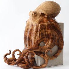 Octopus sculpture, hand carved by award winning, wildlife artist Bill Prickett from a single piece of sweet chestnut burr on nabresina limestone block.