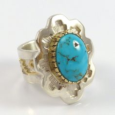 """Sterling Silver Ring with 14k Gold Overlaid Designs and with Natural Lone Mountain Turquoise set in a 14k Gold Bezel. Ring Size: 6 .875"""" Width, 1.125"""" Height .5"""" Band Width"""