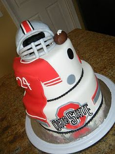 add lacrosse instead of football and probably only one tier but with all that on it and maybe buckeyes around it like the other Ohio state cake has chocolate covered strawberries. Buckeyes Football, Ohio State Football, Ohio State University, Ohio State Buckeyes, Pretty Cakes, Cute Cakes, Ohio State Cake, Buckeye Cake, Buckeye Nut