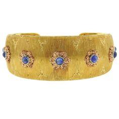 Buccellati Sapphire Gold Cuff Bracelet | From a unique collection of vintage cuff bracelets at https://www.1stdibs.com/jewelry/bracelets/cuff-bracelets/