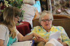 Faculty member Lora Zill and conferee discuss things in the lobby.