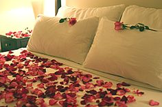 Turn your boudoir into a romantic haven with rose petals heavily sprinkled on your bedding