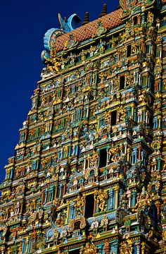 Meenakshi Amman Temple, Madurai, Tamil Nadu, India.  The temple complex houses 14 gateway towers called gopurams, like the one pictured, and there are an estimated 33,000 sculptures.   Although the temple has been on this site about 2500 years, the current structures were built 1623 to 1655.  by Blaine Harrington