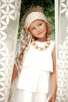 love the textures here.  ruffled shirt/dress, fun head scarf and chunky necklace add so much to this photo.