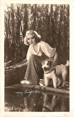 Mary Pickford with a wire fox terrier| 1930s. Two great beauties in one picture.