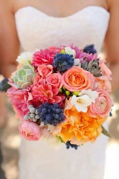 Bright and festive wedding bouquet in pink, orange, and blue!