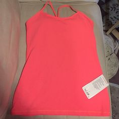NWT Lululemon Power Y Tank size 10 New with tags, lululemon power Y tank size 10 beautiful bright pastel orange . Perfect for yoga or training. Supports B/C cup. Sweat wicking Luon fabric . Tight fit, hip length lululemon athletica Tops Tank Tops