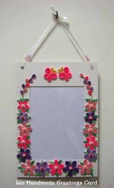 Hanging quilled photo frames