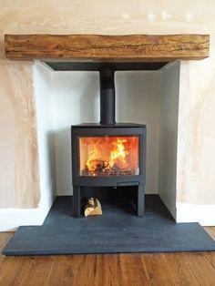 Wood Burner Stove, Wood Burner Fireplace, Cosy Fireplace, Slate Fireplace, Log Burner, Fireplace Ideas, Corner Fireplaces, Cottage Lounge, Home Exterior Makeover