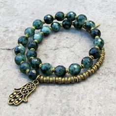 new style! Beautiful, rich, faceted, Moss Agate, a stone known through the ages to attract wealth and abundance... In our signature 27 bead