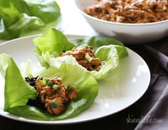 Crockpot Honey Sesame Chicken in lettuce wraps....holy moly this was one of the best recipes I have EVER made. Put a little of the chicken in some butter lettuce leaves with a 1/4 cup brown rice, and you have one healthy, filling meal. I'm dead serious about this one, guys.