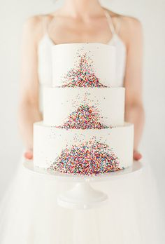 Brides.com: The Best Wedding Cakes of 2014 Allison Kelleher of AK Cake Design in Portland created this modern chevron-patterned cake covered in individually hand-cut and hand-painted triangles arranged to form vertical zigzags. We first included this confection as part of our mosaic cake feature.Photo: AK Cake Design