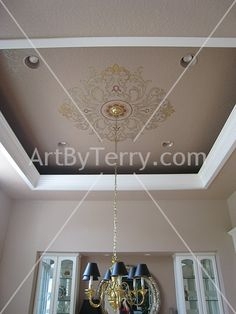 Ceiling design using a Modello stencil with metallic paints and crystals